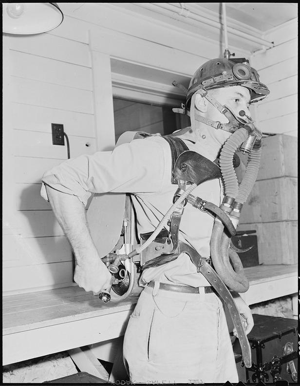 lossy-page1-795px-Member_of_mine_rescue_team_of_safety_department_adjusts_oxygen-breathing_equipment_for_use_in_gaseous_mine_explosion..._-_NARA_-_541454.tif