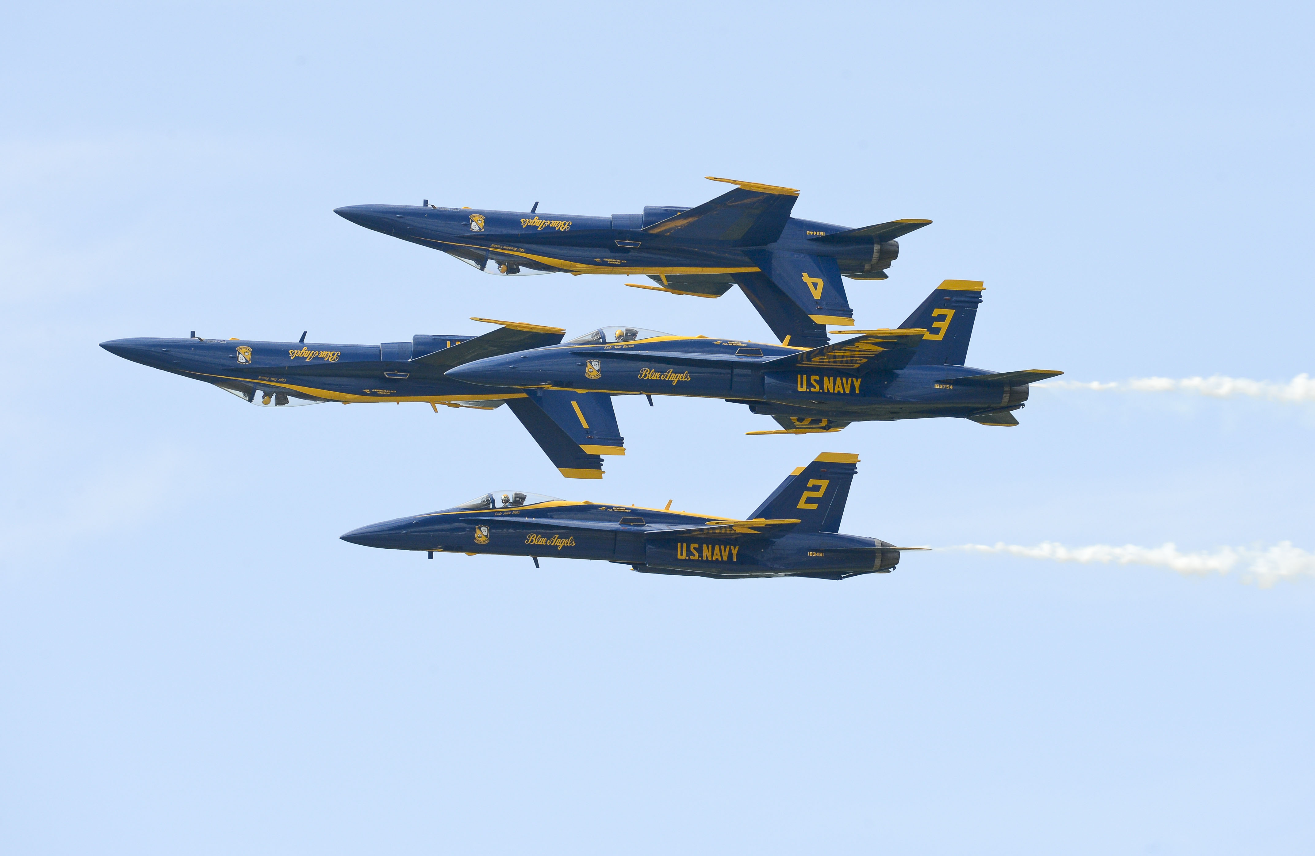 Diamond Pilots perform the Double Farvel maneuver during the air show Sept. 21.